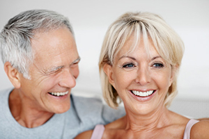 Closeup portrait of a happy mature man with senior woman having fun together